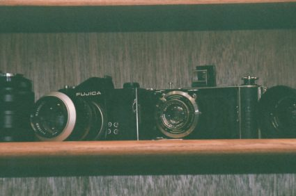 Raw Film shot of Two Cameras on a Shelf