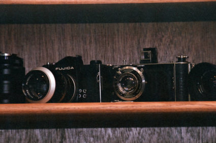 Edited Film shot of Two Cameras on a Shelf